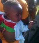 MANO our partners in Kenya, helping to distribute new born baby clothes we donated